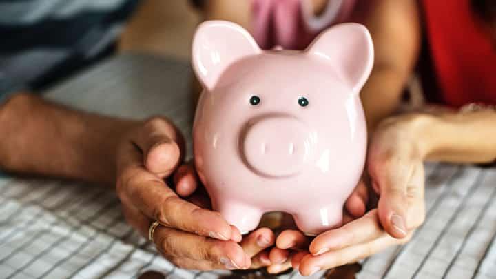 Holding a piggy bank