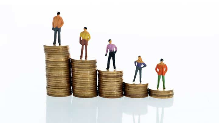 People standing on piles of coins