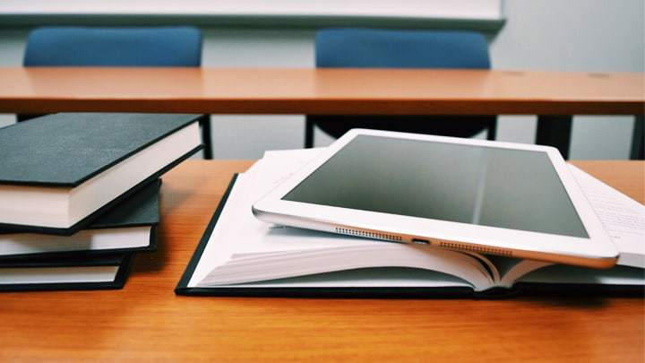 Book and tablet on desk