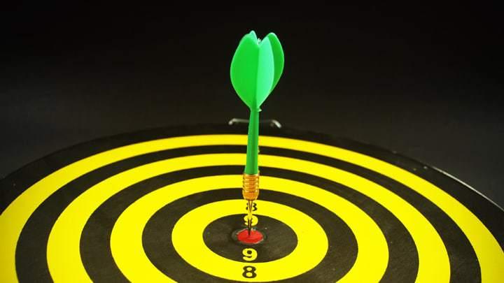 Dart board and green dart