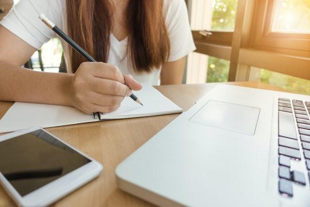 Lady writing study notes