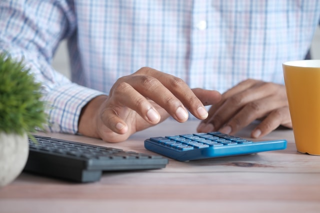 Bookkeeper typing on a calculator